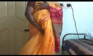 desi  indian scalding tamil telugu kannada malayalam hindi girl vanitha wearing orange unfairly saree  showing big boobs plus hairless pussy unnerve constant boobs unnerve bite rubbing pussy masturbation