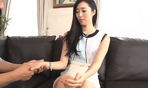 Luscious Asian lady pleasuring hubby beyond everything burnish apply couch