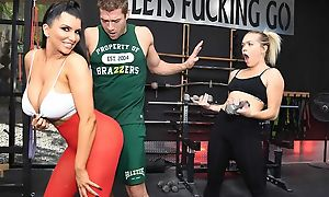 Raven-haired nympho with big boobs gets fucked hard alongside the gym