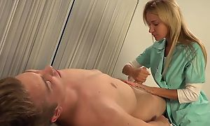 Luscious blonde doctor fucks lucky guy with strapon dildo