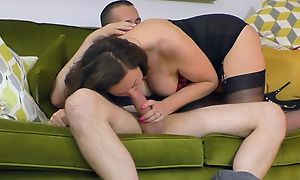 Salacious housewife in black stockings boned in the living room