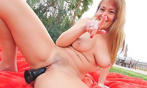 Horny GILF with respect to simple boobs fucks themselves outdoors