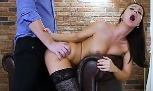 Dark-haired nymph champaign stockings gets aptly fucked