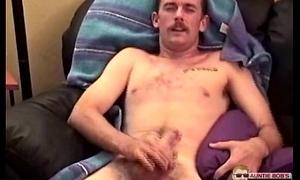 Young man watchin tv masturbating