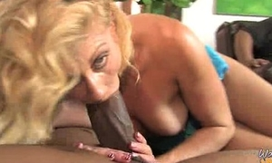 Horny MILF fucks young black scantling 21