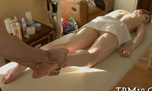 Stud is massaging sweetheart with oil