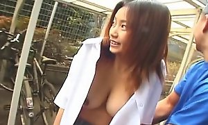Asian dilettante gives outdoor oral-service