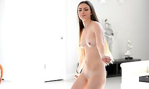 Comely young model dances around surely naked