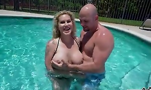 Inked mature with huge melons gets banged in the pool